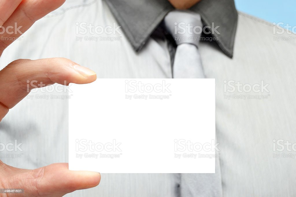 Man with a white card in hand royalty-free stock photo