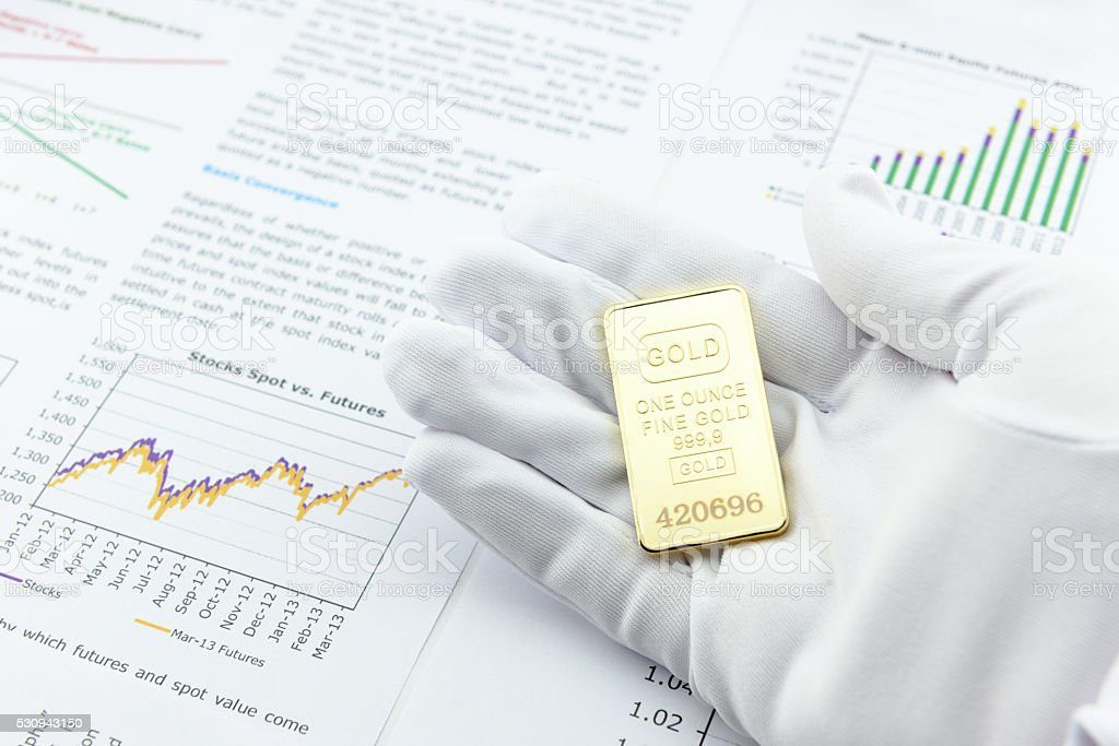 Man with a white handy glove and a gold bar stock photo