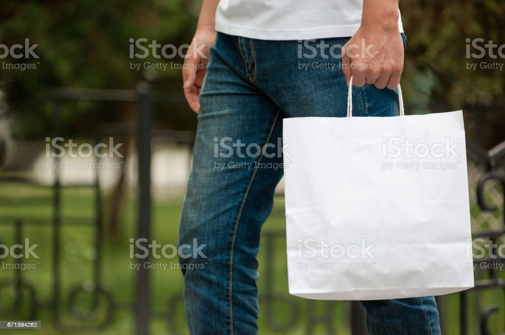man with a white package in his hands стоковое фото