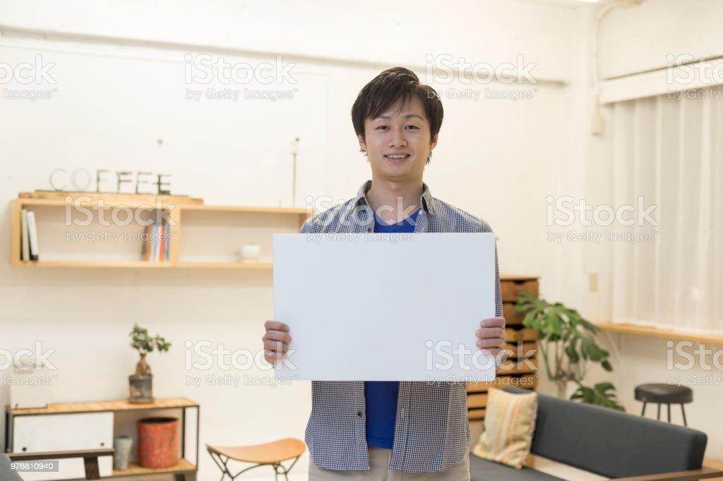 ホワイト ボードを持つ男 ストックフォト