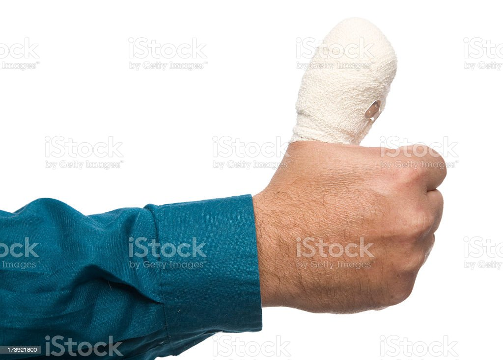 Man with a wrapped up sore thumb stock photo