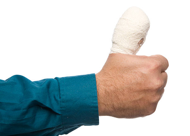 man with a wrapped up sore thumb - thumb stock photos and pictures