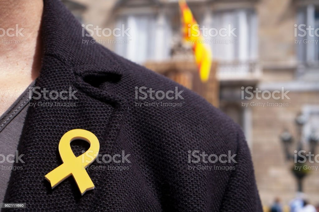 man with a yellow ribbon in Barcelona, Spain stock photo