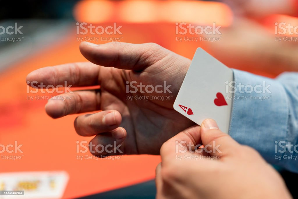 Man with an ace under his sleeve at the casino stock photo