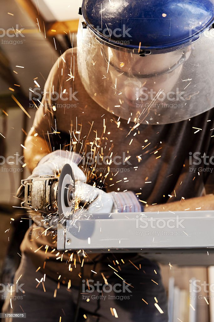 Man with an Angle Grinder stock photo