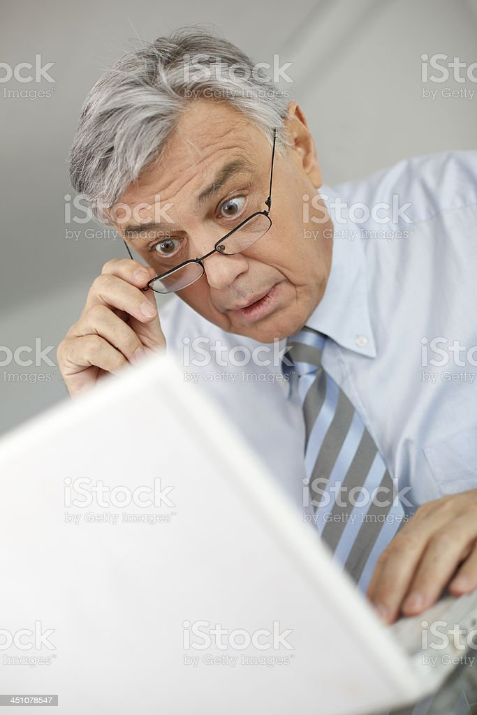 Man with an astonish look working on laptop royalty-free stock photo