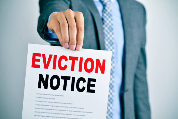 man with an eviction notice stock photo