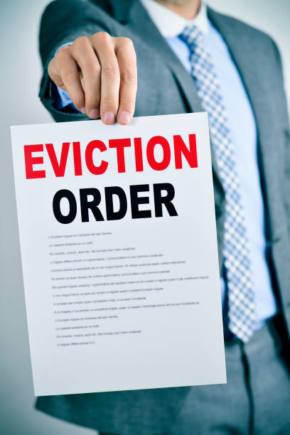 man with an eviction order stock photo