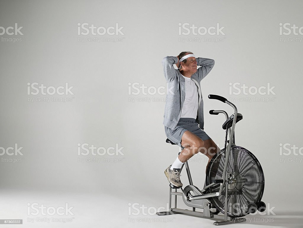 Man with an exercise bike royalty-free stock photo