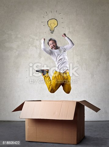 istock Man with an idea jumping out of a box 518505422