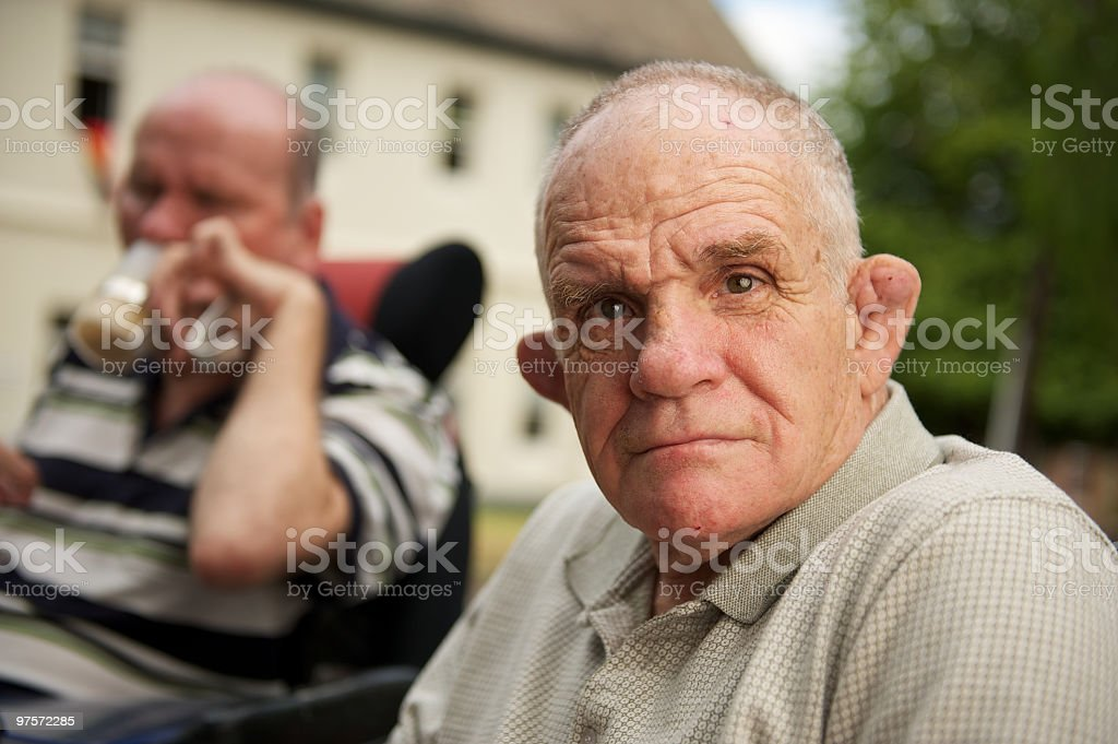 Man with an intellectual disability looking at the camera. stock photo