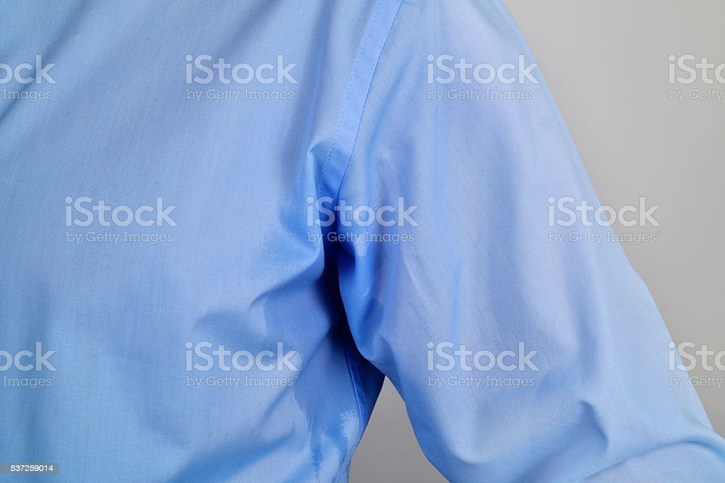 man with an sweat stain in his underarm stock photo
