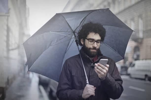 Man with an umbrella stock photo