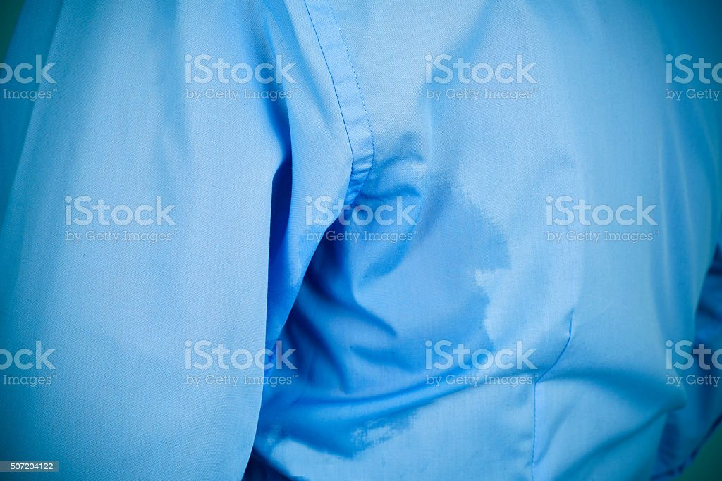 man with an underarm sweat stain stock photo