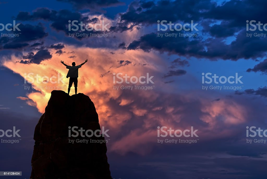 Man with arms raised in the sky winner success concept - foto stock