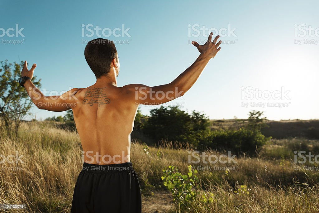 Man with arms raised into sky royalty-free stock photo