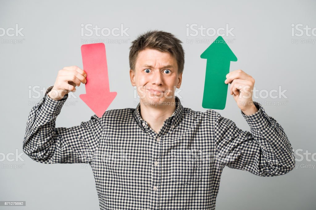 Man with arrows stock photo