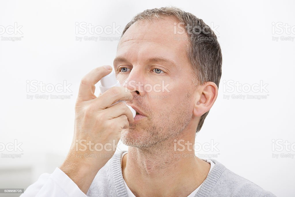 Man With Asthma Inhaler stock photo