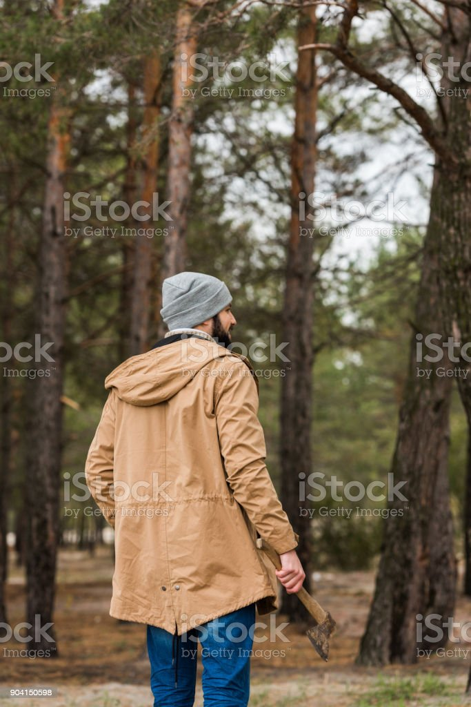 man with axe in forest stock photo