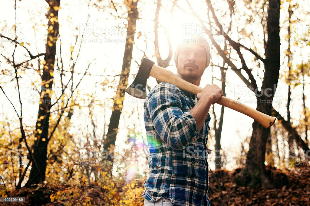 Man with axe in the forest – Foto