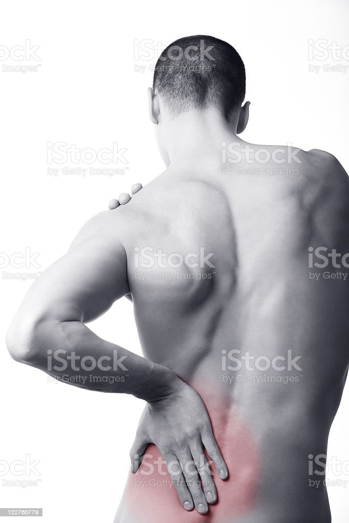 man with back pain in the red zone royalty-free stock photo