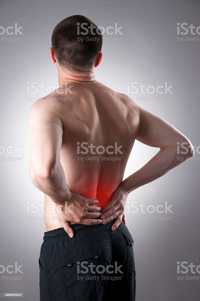 Man with backache. Pain in the human body stock photo