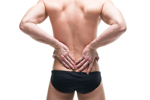 537234318 istock photo Man with backache. Pain in the human body 513235292