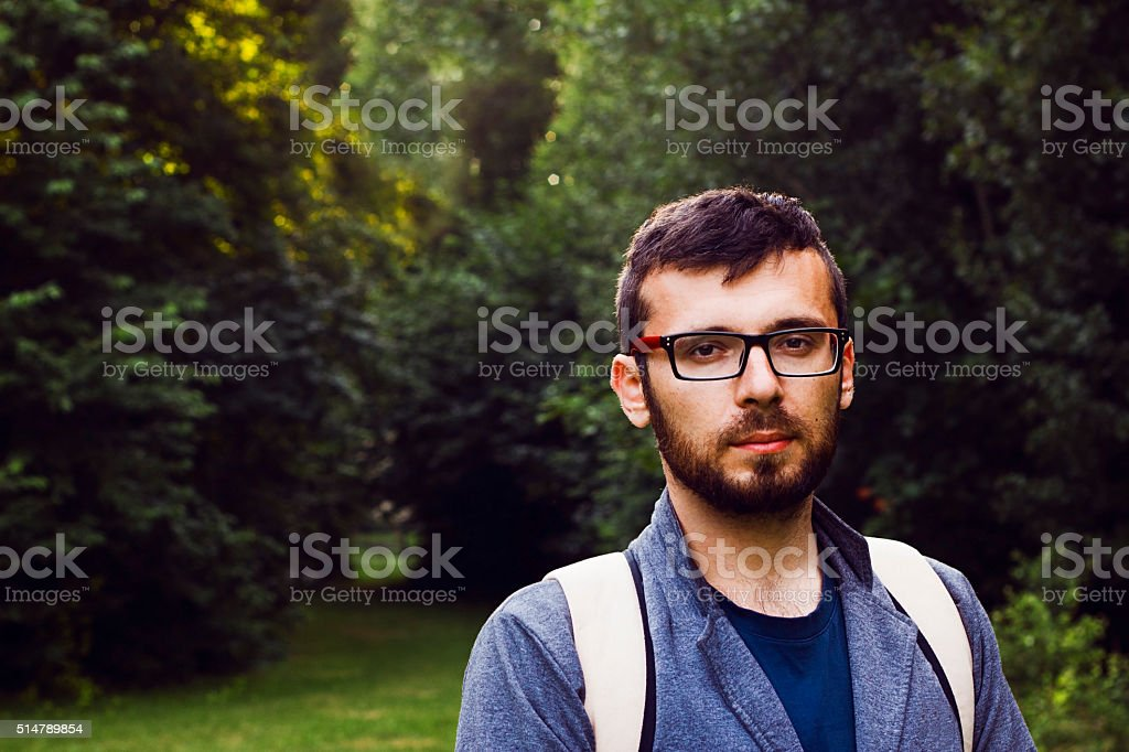 Man with backpack in the forest stock photo