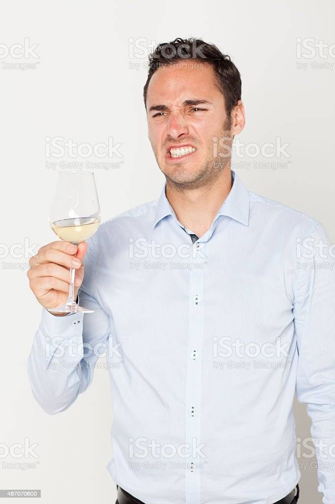 Man with bad wine stock photo