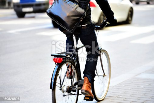 863454090 istock photo Man with bag on bicycle in motion 160526526