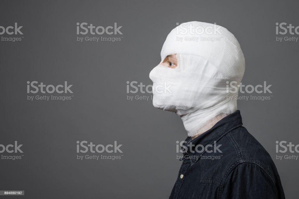 Man with bandage on head stock photo