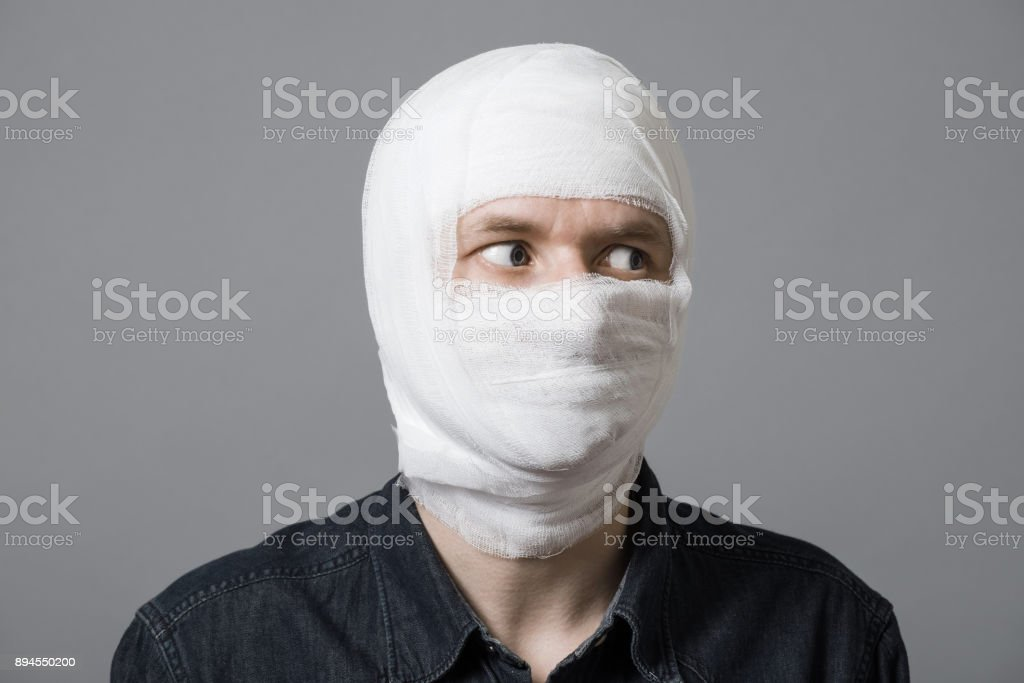 Man with bandage on head stock photo