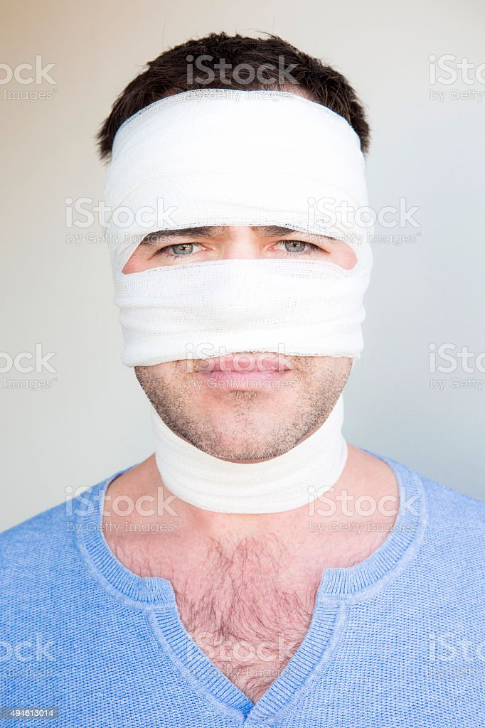 man with bandages stock photo
