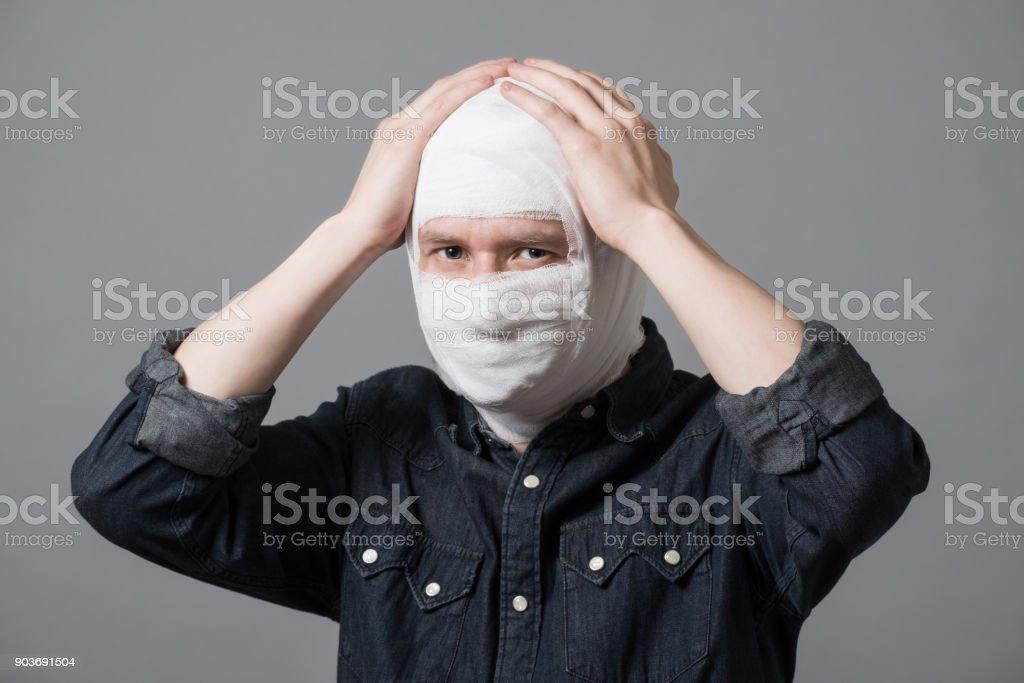 Man with bandge on his head stock photo