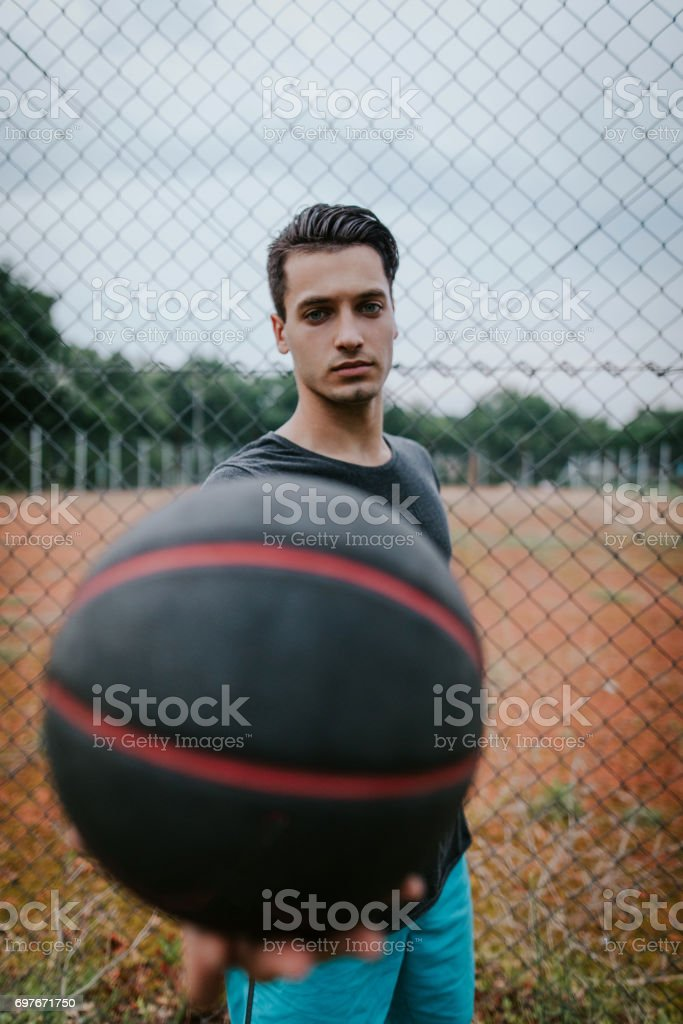 Man with basketball in hands stock photo
