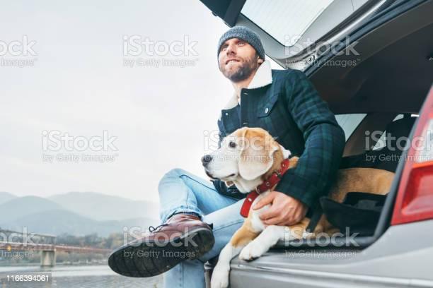 Man with beagle dog siting together in car trunk picture id1166394061?b=1&k=6&m=1166394061&s=612x612&h=gqv7tcncuzmcr2pqxwbklgc 3qb6slhnzmlod5jinxu=