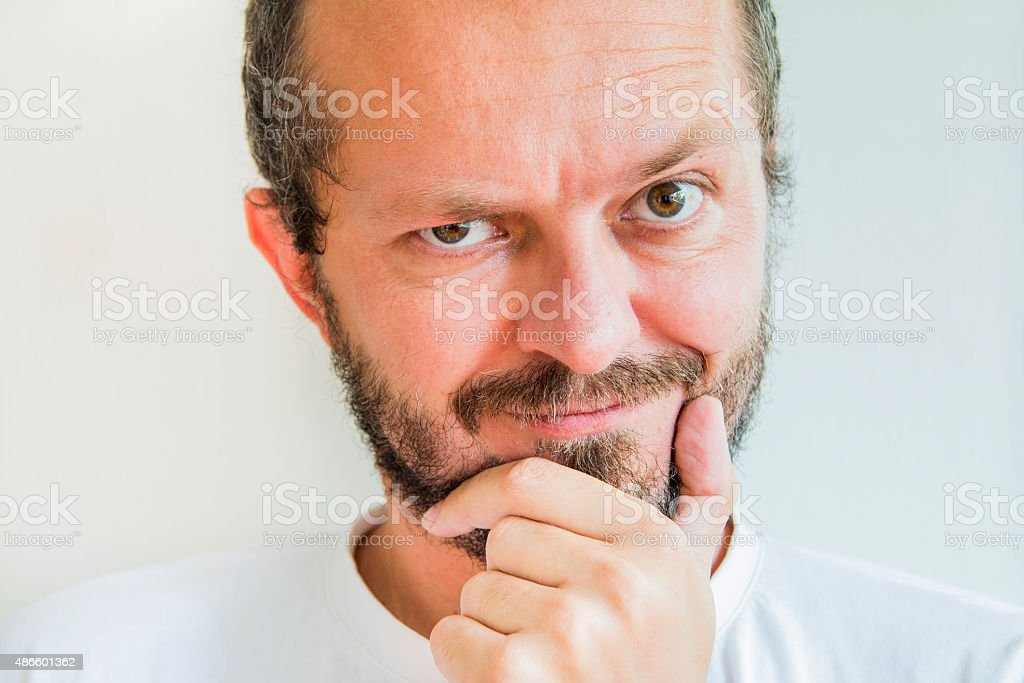 Man with beard and mustaches, skeptic and mean expression stock photo