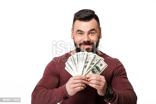 istock man with beard holding money dollar bills 969671638