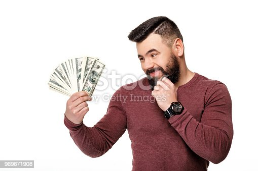 969671638istockphoto man with beard holding money dollar bills 969671908
