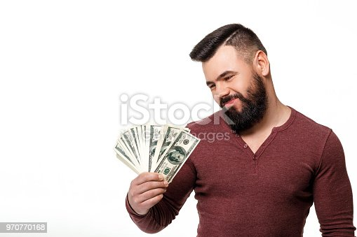 969671638istockphoto man with beard holding money dollar bills 970770168