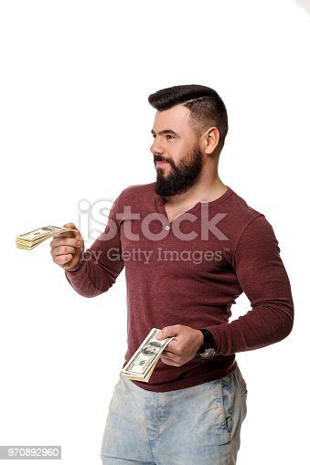 969671638istockphoto man with beard holding money 970892960