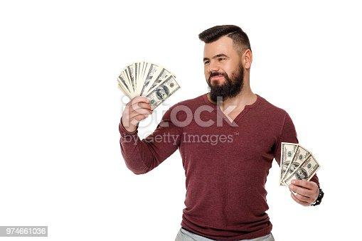 969671638istockphoto man with beard holding money 974661036