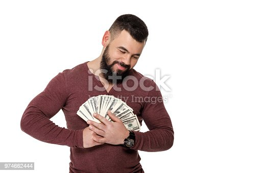 969671638istockphoto man with beard holding money 974662444