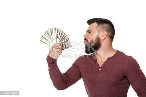 969671638istockphoto man with beard holding money 974663402
