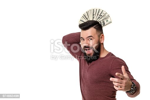 969671638istockphoto man with beard holding money 974663498