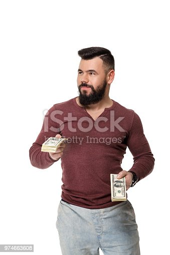 969671638istockphoto man with beard holding money 974663608