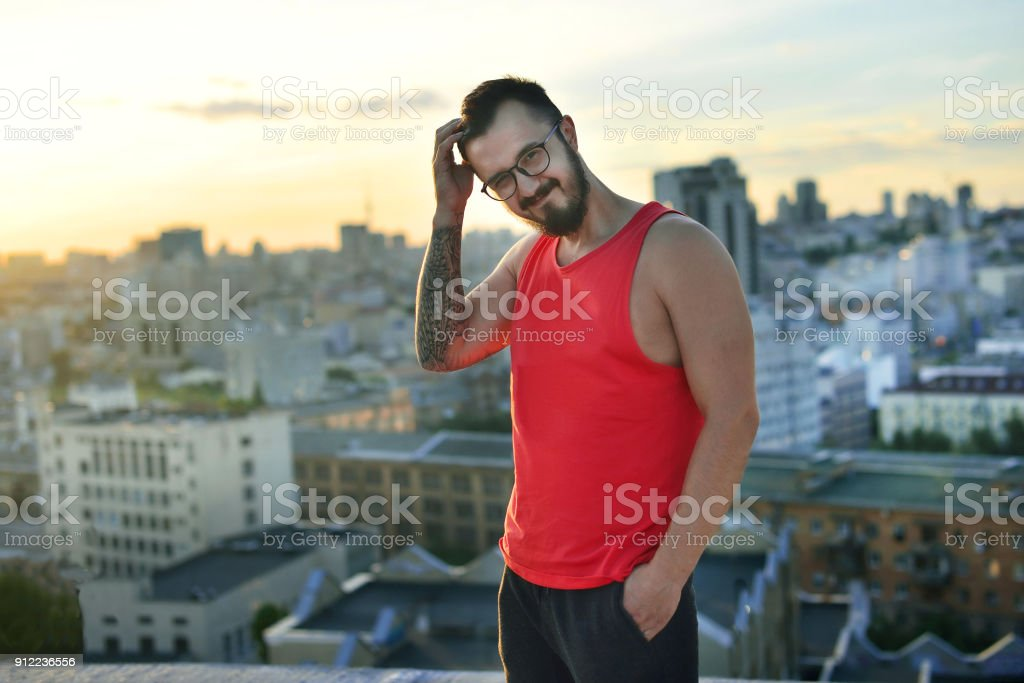 Man with beard on the top of cityscape stock photo