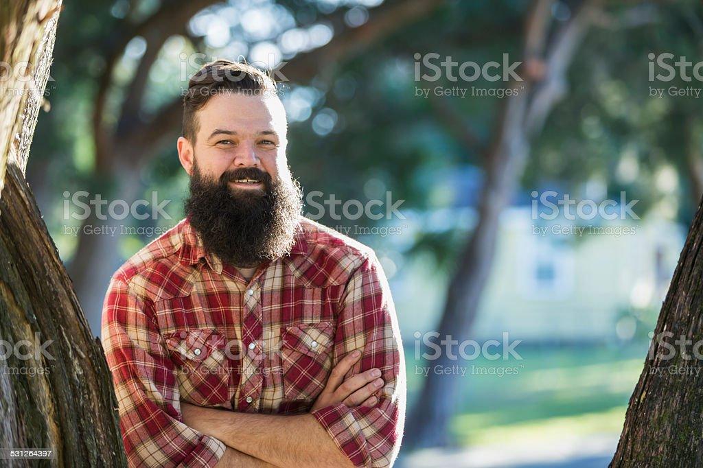 Man with beard wearing plaid shirt stock photo