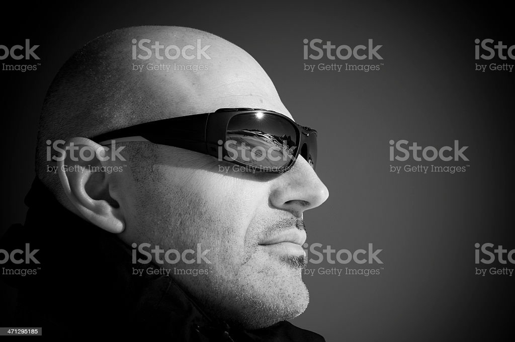 Man with beautiful winter landscape reflected in his sunglasses stock photo