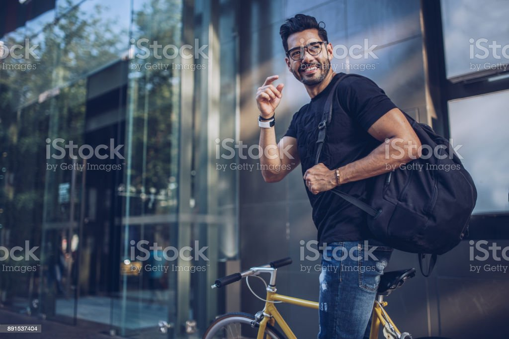 Man with bicycle in city stock photo